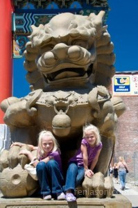 Alyssa and Carlye climbing on the China Town entrance