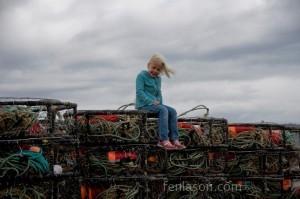 Alyssa atop crab traps
