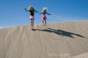 Alyssa & Carlye jumping off the dunes!