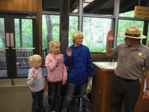 Kids take the Junior Ranger oath with the Ranger in Olympic National Park