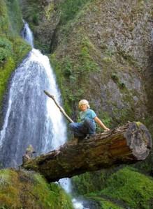 Jordan climbing a log above Wahkeena Falls