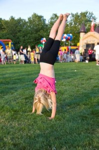 Carlye doing handstands