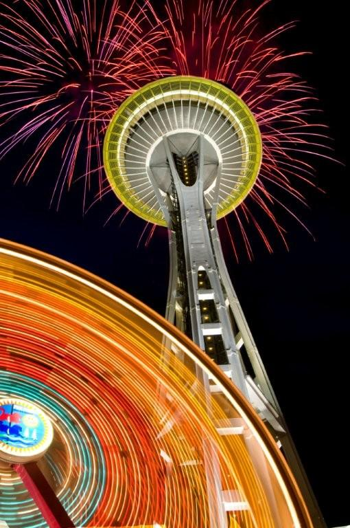 Space Needle and Ferris Wheel with fireworks