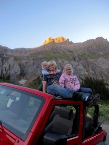 Jordan, Carlye, & Alyssa on the jeep at Yankee Boy Basin